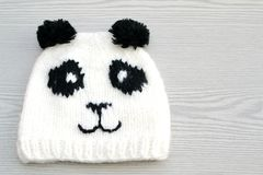 Cute hand knitted panda hat Royalty Free Stock Photos