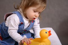 Cute handicapped girl with toy Royalty Free Stock Images