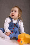 Cute handicapped girl with toy Stock Photography