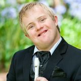 Cute handicapped musician with flute. Royalty Free Stock Image