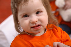 Cute Handicapped Toddler. Portrait of a cute little girl, slightly less than two years old, with Downs Syndrome stock image