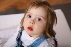 Cute handicapped toddler. A cute little toddler looking up at the camera.  Little girl has Downs Syndrome Stock Image