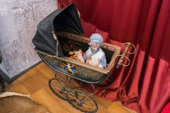 Cute handmade dolls in a carriage painted by an artist stock photography