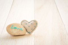 Cute handmade heart and glitter love word on stone Stock Image