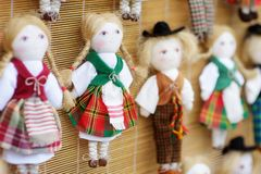 Cute handmade ragdoll dolls in Lithuanian national costumes sold on Easter market in Vilnius. Lithuanian capital`s annual traditional crafts fair is held every Royalty Free Stock Photos
