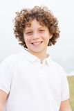Cute handsome boy enjoys posing. Young beautiful boy posing at outdoor Royalty Free Stock Photo