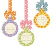 Cute hanging labels. Illustration of cute hanging label with a polka-dot bows Royalty Free Stock Images