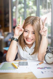 Cute happy asia girl working in coffeeshop royalty free stock image