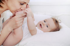 Cute happy baby boy with his caring mother Royalty Free Stock Image