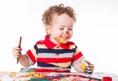 Cute happy baby boy playing with paints Stock Photography