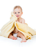 Cute happy baby boy in towel Stock Photography