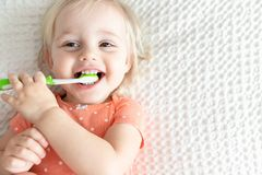 Cute Happy Baby Brushing Teeth and Smiling. Copy Space. Happy Little Baby with Toothbrush. Dentistry Children`s Concept. Copy Space. Smile. Health royalty free stock photo