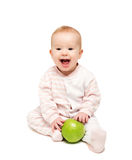 Cute happy baby with fruit green apple isolated Stock Image