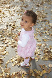 Cute happy baby girl among autumn leaves Stock Photography