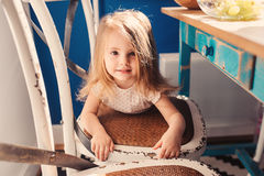 Cute happy baby girl having fun on the kitchen Stock Photos