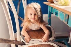 Cute happy baby girl having fun on the kitchen Stock Photos
