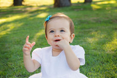 Cute happy baby girl smiling, scratching first teeth Royalty Free Stock Photography