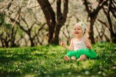 Cute happy baby girl walking outdoor in spring garden. Happy childhood concept Stock Images