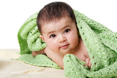 Cute happy baby between green blankets Royalty Free Stock Photo