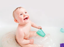 Cute happy baby laughing in a bathroom Stock Image