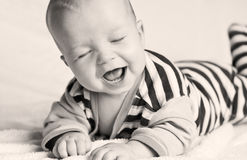 Cute happy baby. Happy little baby laughing with eyes closed (black and white Royalty Free Stock Images