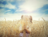 Cute happy baby playing on wheat field,outdoor Stock Photo