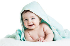 Cute happy baby in towel
