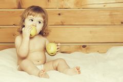 Boy eating apples royalty free stock images