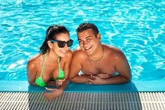 Cute happy bikini woman with nice breast in swimming pool Royalty Free Stock Photos
