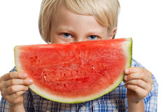CUte happy boy hiding behind watermelon Royalty Free Stock Photos