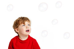 Cute Boy playing Bubbles. Cute Happy boy playing with bubbles shot in the studio on a white background Stock Photography