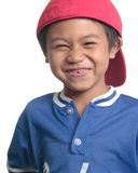 Cute happy boy in red baseball cap Royalty Free Stock Images