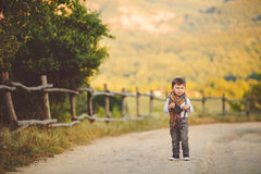 Cute happy boy on the street. Stylish baby boy having fun outside in the park. Cute happy boy child outdoors Stock Photography