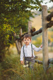 Cute happy boy on the street. Stylish baby boy having fun outside in the park. Cute happy boy child outdoors Royalty Free Stock Images