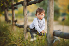 Cute happy boy on the street. Stylish baby boy having fun outside in the park. Cute happy boy child outdoors Stock Image