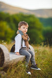Cute happy boy on the street. Stylish baby boy having fun outside in the park. Cute happy boy child outdoors Stock Photos