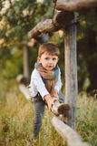 Cute happy boy on the street. Stylish baby boy having fun outside in the park. Cute happy boy child outdoors Royalty Free Stock Photo