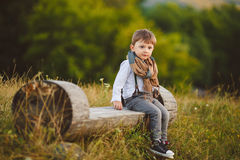 Cute happy boy on the street. Stylish baby boy having fun outside in the park. Cute happy boy child outdoors Royalty Free Stock Image