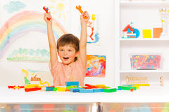 Cute happy boy with wrenches in the kindergaten Stock Photography