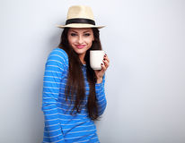 Cute happy casual woman in straw hat holding in hand cup of tea Royalty Free Stock Photo