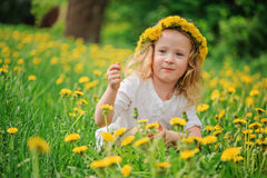 Cute happy child girl on dandelion flower field Royalty Free Stock Photography