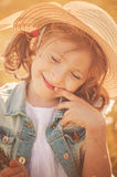 Cute happy child girl in hat portrait in summer Stock Photos