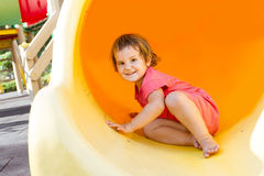 Cute happy child girl on playground Royalty Free Stock Image