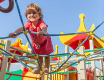 Cute happy child girl on playground Royalty Free Stock Photos
