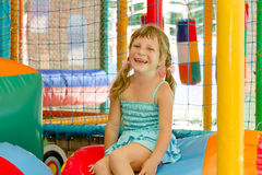 Cute happy child girl on playground Stock Photos