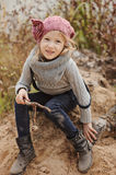 Cute happy child girl playing on the river side in autumn Stock Images