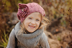 Cute happy child girl portrait in autumn Stock Photos