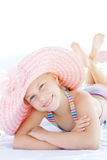 Cute happy child lying down on deckchair of beach resort. For summer holidays or travel vacations. Summer vacation idea Royalty Free Stock Images