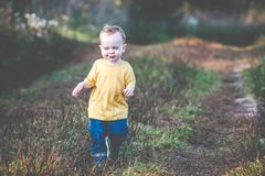 Cute happy child outdoors stock photography