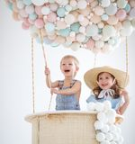 Happy children in a fairy magic hot air balloon Royalty Free Stock Image